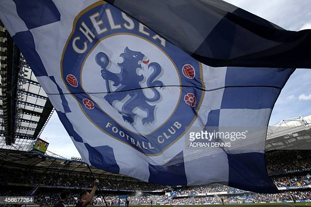 A large chelsea flag is paraded inside the stadium before the English Premier League football match between Chelsea and Arsenal at Stamford Bridge in...