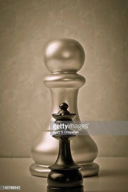 Large chess pawn and small queen