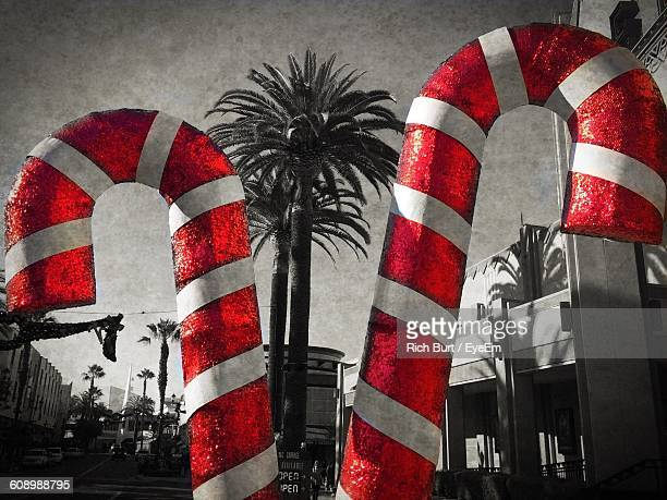 Large Christmas Candy Decoration By Building Against Sky