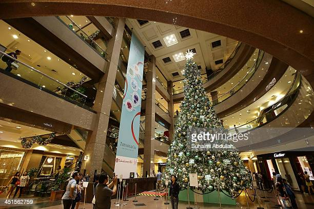 A large Christmas tree decorates the interior of the Takashimaya shopping mall along Orchard Road on November 23 2013 in Singapore Attracting...