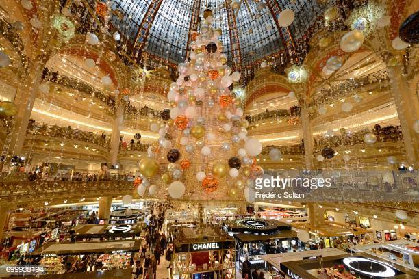 Large Christmas tree decorating Galeries Lafayette store floor on January 8 2017 in Paris France