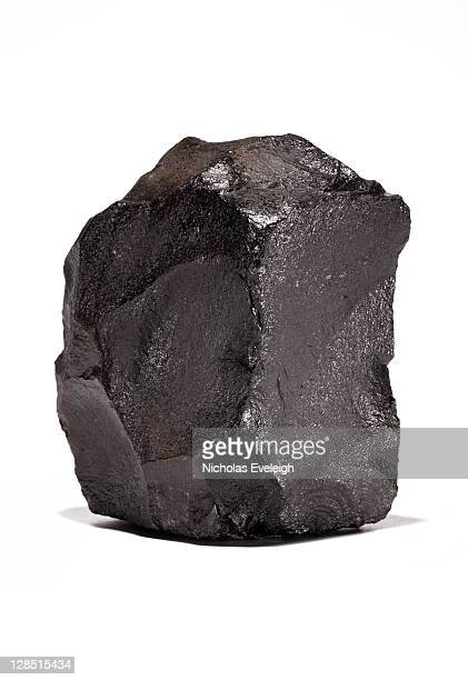 Large chunk of black coal on a white background