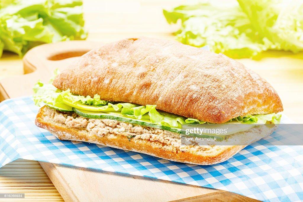 Large ciabatta sandwich with tuna, green, apple and cucumber : Stock Photo