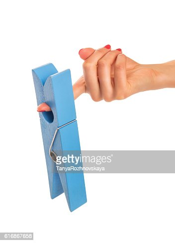 Large clothes pin in his hand. : Stock Photo