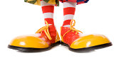 Large clown feet in yellow and red shoes