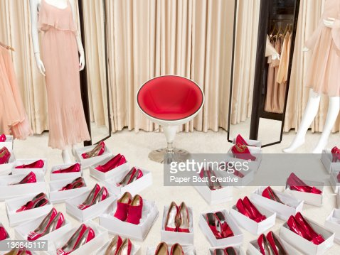 large collection of red shoes in boxes in a shop