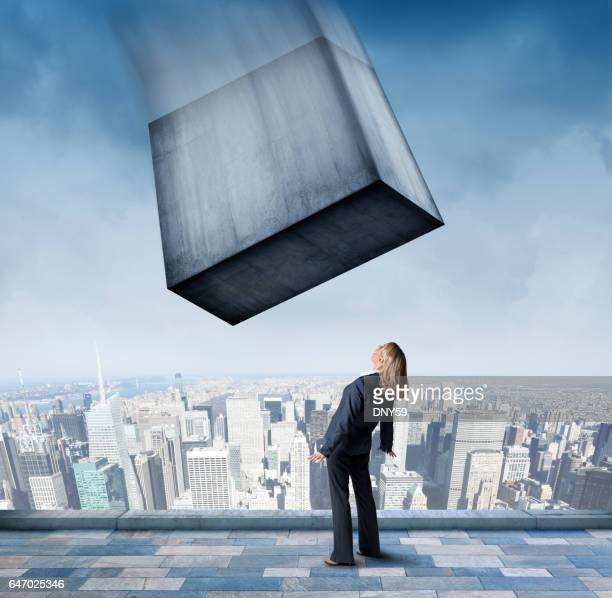 Large Concrete Block About To Fall On Businesswoman