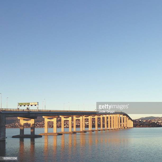Large concrete bridge crossing river