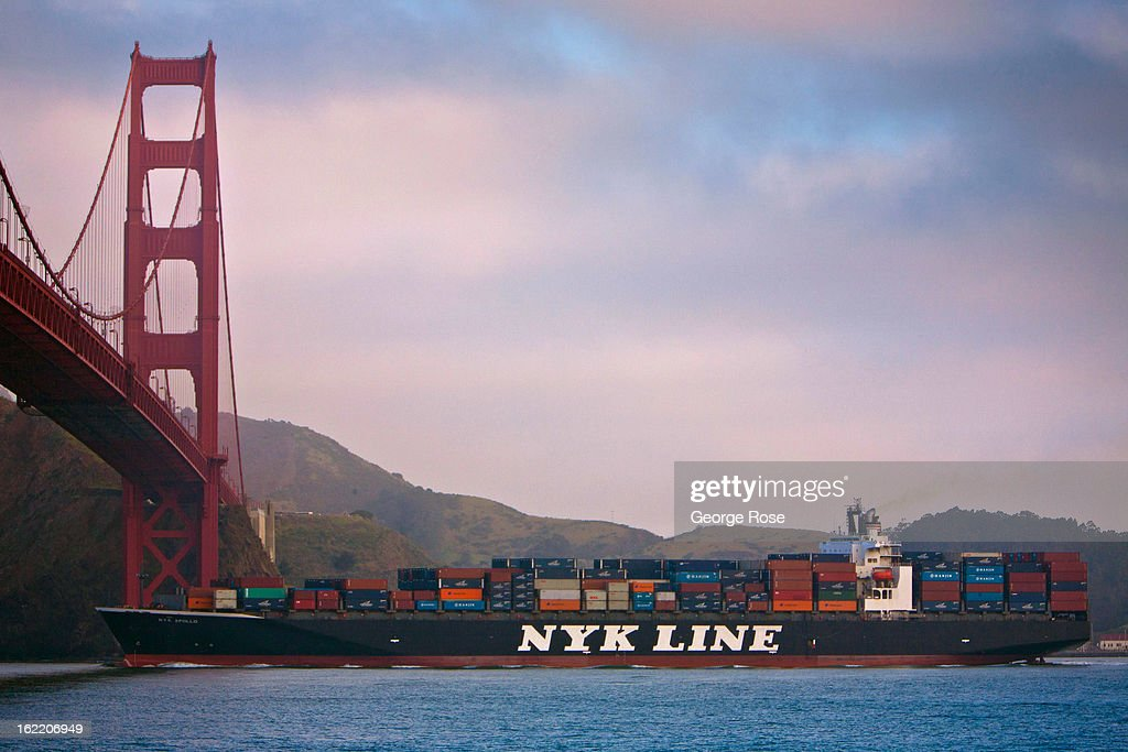 A large container ship passes under the Golden Gate Bridge near the Marin Headlands on February 13, 2013, in San Francisco, California. Some 13.6 million international travelers visit the State each year generating nearly $100 billion in revenue and creating approximately 900,000 jobs in the arts, entertainment, recreation, food service and accomodations sectors.