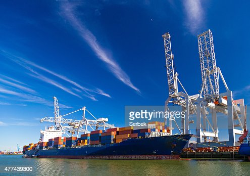Large container vessel unloaded in Port of Rotterdam : Stock Photo