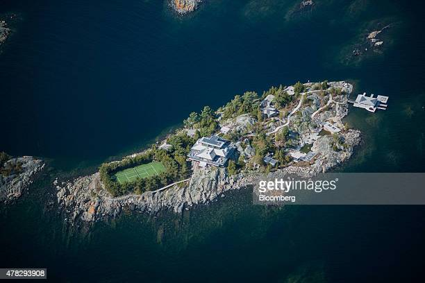 A large cottage stands on an island of the Georgian Bay on Lake Huron in this aerial photograph taken above Muskoka Ontario Canada on Saturday May 23...