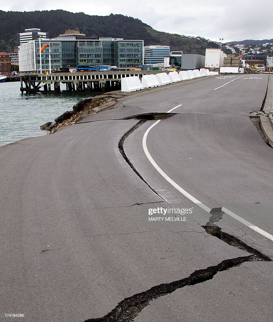 Large cracks are seen in the road near where the land fell into the sea at the Port Wellington Container terminal caused by yesterdays earthquake on July 22, 2013. Wellington city was hilt by a 6.5 magnitude earthquake on Sunday afternoon at 5.06pm on July 21 causing medium damage to the city.