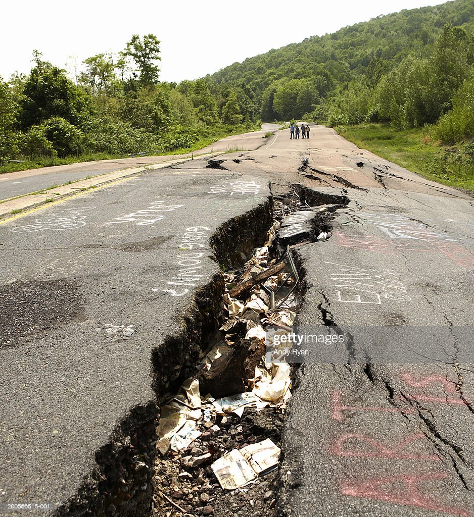 Large cracks in road after earthquake