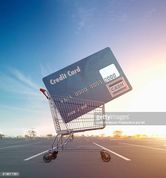 Large credit card in shopping cart in parking lot