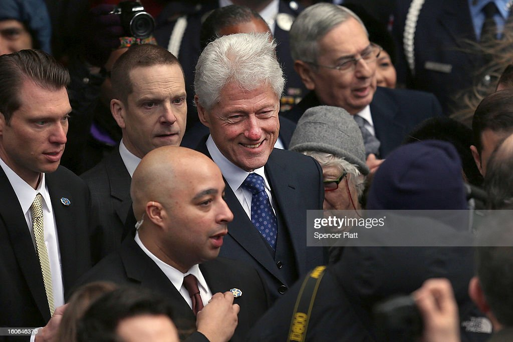 A large crowd gathers around former U.S. President Bill Clinton (C) following the funeral services for former New York Mayor Ed Koch at Manhattan's Temple Emanu-El on February 4, 2013 in New York City.The iconic former New York mayor passed away on February 1, 2013 in New York City at age 88. Ed Koch was New York's 105th mayor and ran the city from 1978-89. He was often outspoken and combative and has been credited with rescuing the city from near-financial ruin during a three-term City Hall run.