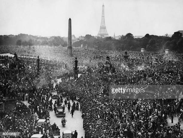 A large crowd gathers on August 26 1944 to cheer French General Charles de Gaulle at Place de la Concorde the day after Paris was liberated / AFP...