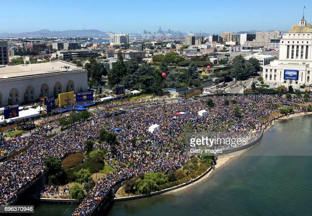 A large crowd gathers to watch the Golden State Warriors victory parade and rally on June 15 2017 in dowtown Oakland California An estimated crowd of...