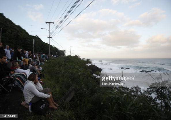 A large crowd lines up along Kamehameha Highway looking into Waimea Bay to watch the 2009 Eddie Aikau BigWave Invitational on December 8 2009 in...
