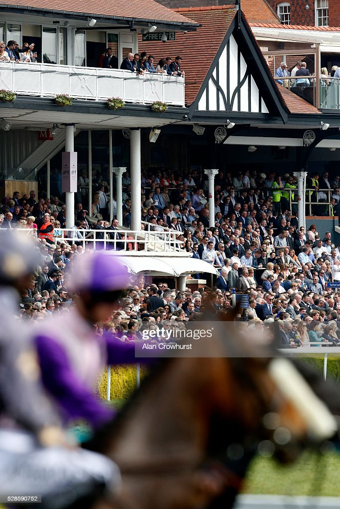 A large crowd look on as runners wait at the start at Chester racecourse on May 6, 2016 in Chester, England.