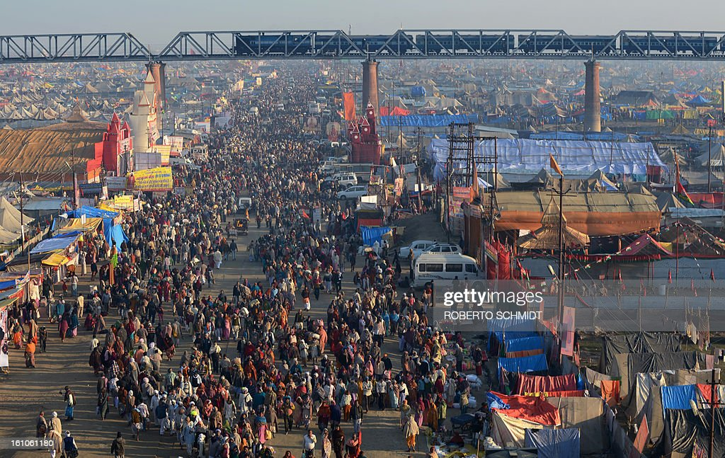 A large crowd makes its way on one of the pedestrian access points into the grounds of the Kumbh Mela, a day before authorities expect the largest crowd during the most auspicious day of the festival, in Allahabad on February 9, 2013. The Kumbh Mela in the town of Allahabad will see up to 100 million worshippers gather over 55 days to take a ritual bath in the holy waters, believed to cleanse sins and bestow blessings.