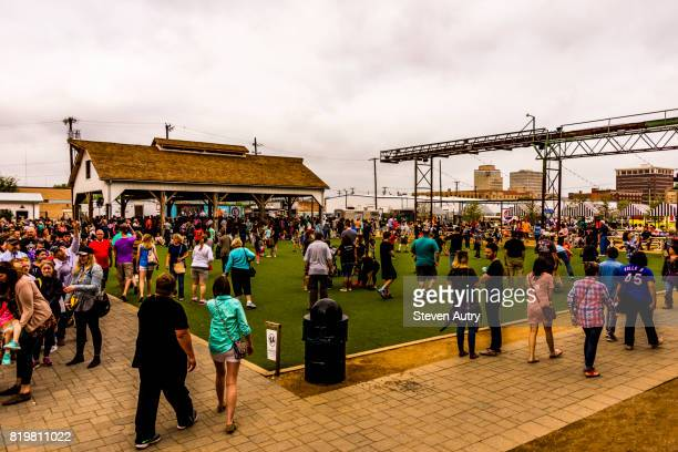 WACO, TX, USA  MARCH 18, 2017: Large crowd of patron's waiting in the relaxation area behind Magnolia Market at the Silos.