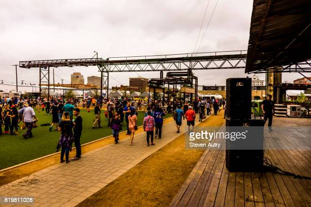WACO, TX, USA  MARCH 18, 2017: Large crowd of patron's waiting in the relaxation area behind Magnolia Market with the live entertainment stage to the side at the Silos.