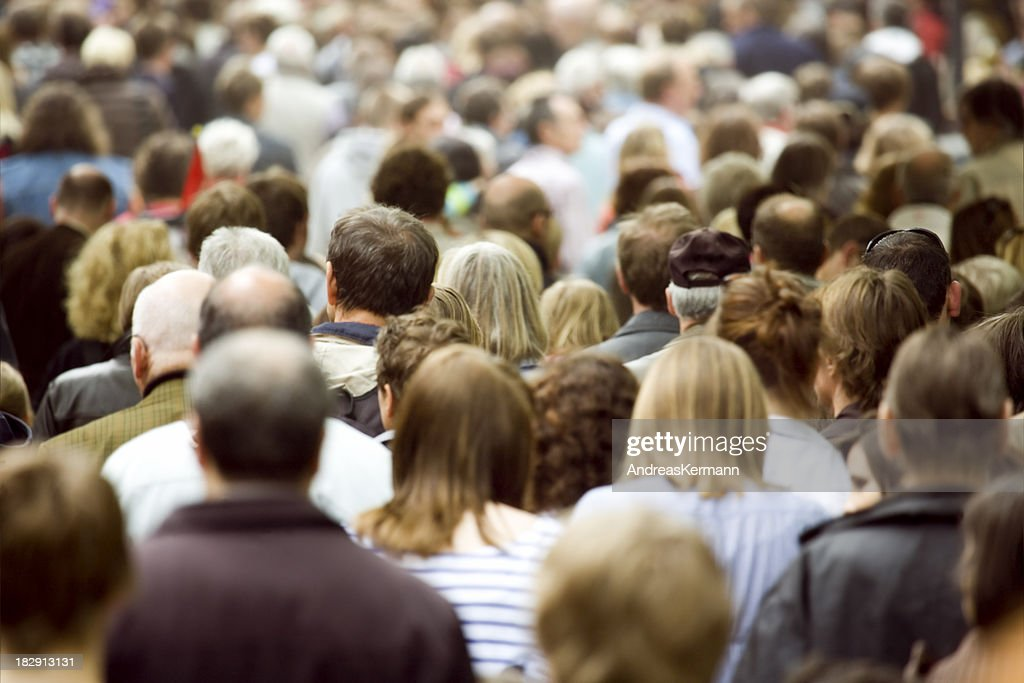 Large crowd of pedestrians walking : Stock Photo