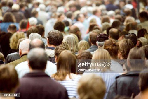 Large crowd of pedestrians walking