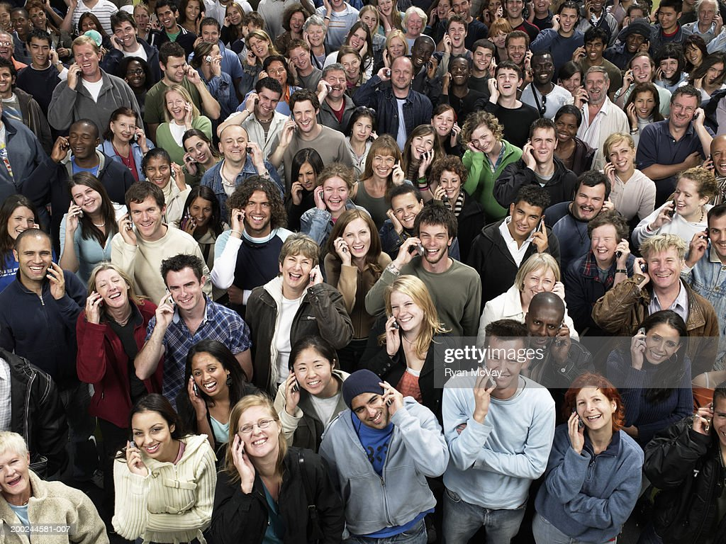 Large crowd of people all using mobile phones, elevated view : Stock Photo