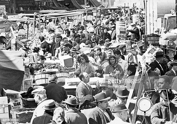 A large crowd of people fills Blackstone Street in Boston to shop at the market on April 4 1964
