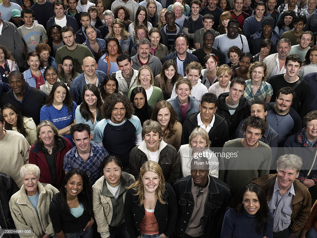 Large crowd of people looking up, smiling, portrait, elevated view : Stock Photo