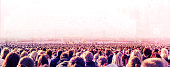 Panoramic photo of large crowd of people. Slow shutter speed with motion blur.
