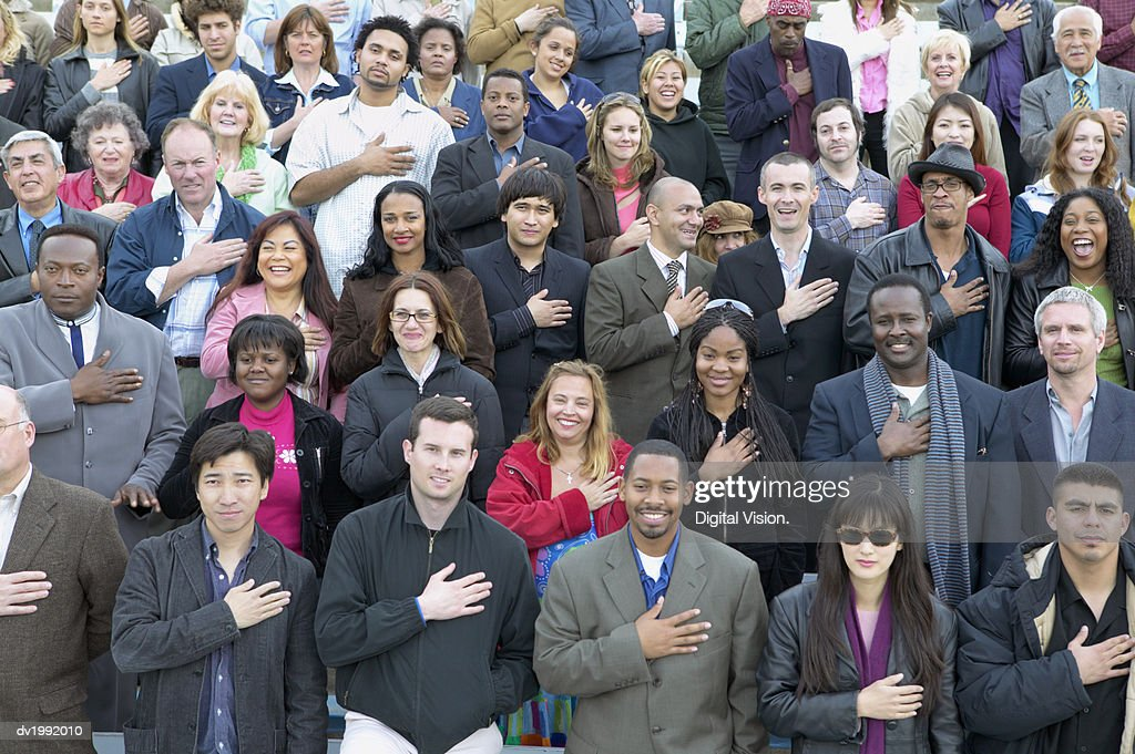 Large Crowd of People Standing in Rows and Pledging Allegiance : Stock Photo