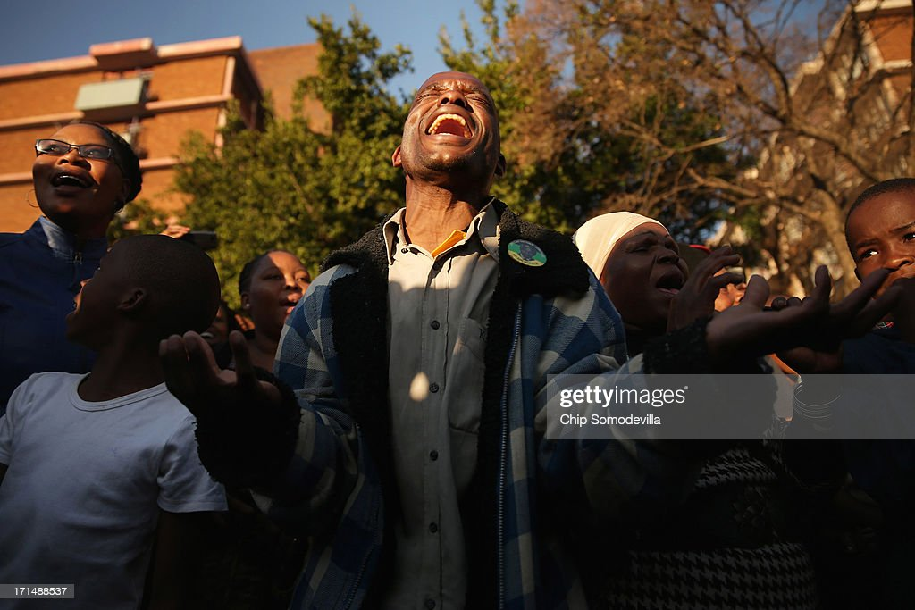 A large crowd of supporters sing songs of support outside of the Mediclinic Heart Hospital where former South African President Nelson Mandela is being treated June 25, 2013 in Pretoria, South Africa. South African President Jacob Zuma confirmed on June 23 that Mandela's condition has become critical since he was admitted to the hospital over two weeks ago for a recurring lung infection.
