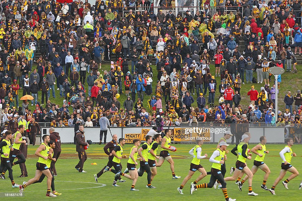 A large crowd of supporters watch as the Hawks run during a Hawthorn Hawks AFL training session at Waverley Park on September 26, 2013 in Melbourne, Australia. The Hawthorn Hawks play the Fremantle Dockers this Saturday in this year's 2013 AFL Grand Final.