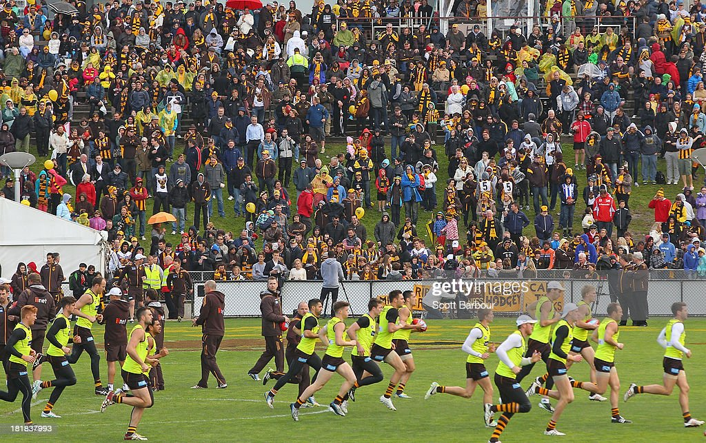 A large crowd of supporters watch as the Hawks train during a Hawthorn Hawks AFL training session at Waverley Park on September 26, 2013 in Melbourne, Australia. The Hawthorn Hawks play the Fremantle Dockers this Saturday in this year's 2013 AFL Grand Final.