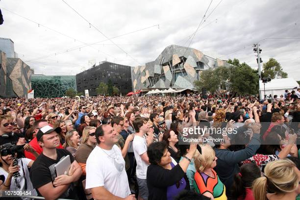 A large crowd packs into Federation Square during a public event at Federation Square on December 10 2010 in Melbourne Australia Oprah Winfrey is in...