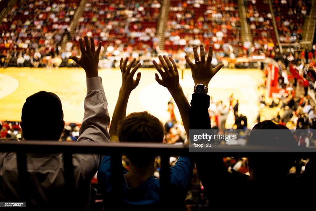 Large crowd of people attend a sports event. Stadium. Basketball.