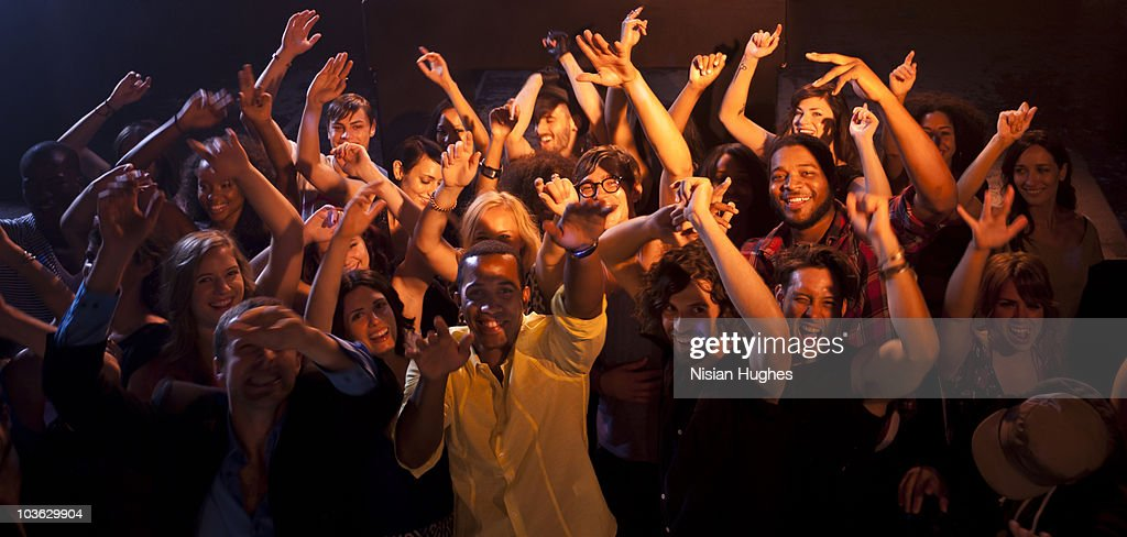 Large crowd pointing at camera : Stock Photo
