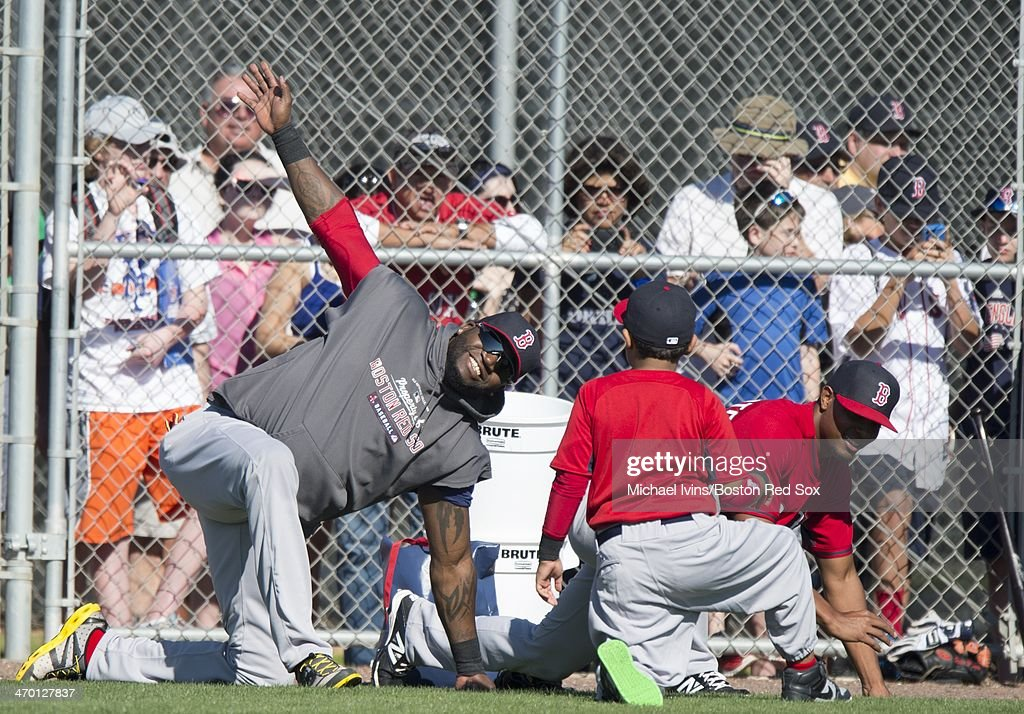 A large crowd watches as David Ortiz #34 of the Boston Red Sox stretches during a Spring Training workout at Fenway South on February 18, 2014 in Fort Myers, Florida.