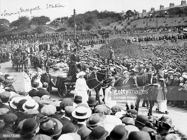 A large crowd watches Emily Wilding Davison's funeral procession leaving Morpeth station 15th June 1913 She died after stepping out in front of King...