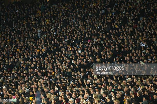 A large crowd watches the TriNations Bledisloe Cup match between the New Zealand All Blacks and the Australian Wallabies at Eden Park on August 6...