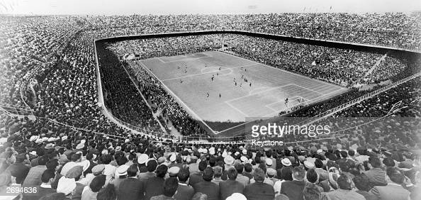 A large crowd watching a football match at the San Siro Stadium in Milan originally built in 1926