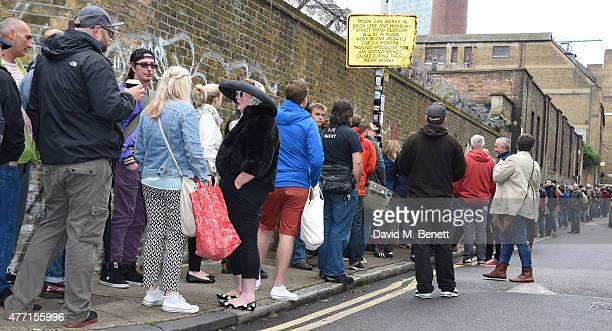 Large crowds await the opening of the Vauxhall Art Car Boot Fair 2015 on June 14 2015 in London England