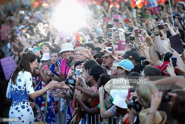 Large crowds cheer and try to catch a glimpse of Catherine Duchess of Cambridgas she does a walkabout on the South Bank on April 19 2014 in Brisbane...