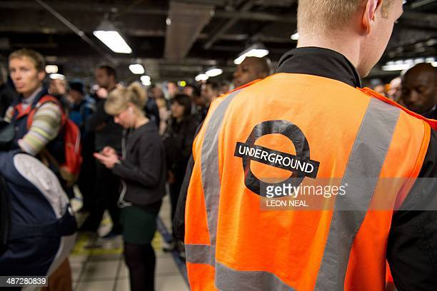 Large crowds gather as the station gates remain closed into rush hour at Victoria station in London on April 29 as a planned 48 hour underground...