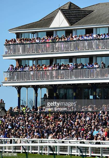 Large crowds in the main stand watch on during the QTS Scottish Champion Hurdle Race on the second day of the Scottish Grand National Festival at Ayr...