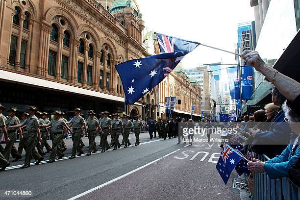 Large crowds line George Street and wave Australian flags during the Anzac Day Parade on April 25 2015 in Sydney Australia Australians are...