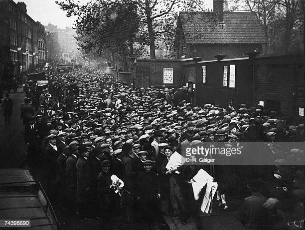 Large crowds of fans waiting to get into Arsenal's Highbury Stadium for the game against Aston Villa 8th November 1930 The match winners will go top...