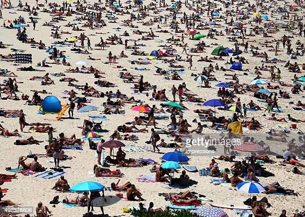 Large crowds of people are seen on Bondi Beach which is one of the most famous beaches in the world in Sydney New South Wales Australia